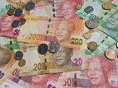 picture of nelson mandela  - South African new bank notes and coins  in piles - JPG