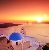 View of a blue dome of the church St. Spirou in Firostefani on the island of Santorini Greece, at su