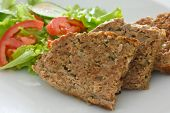 Baked meatloaf and fresh salad