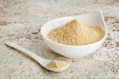 stock photo of ceramic bowl  - maca root powder  - JPG