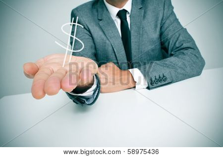 a businessman sitting in a desk showing a drawn dollar sign in his hand poster