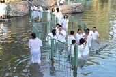 Yardenit, Israel - January 21: The ritual baptism of Christian pilgrims in the sacred waters of the