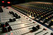 stock photo of recording studio  - A sound board with colored knobs and sliders - JPG
