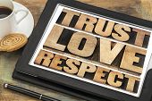 trust, love and respect word abstract in vintage letterpress wood type on a digital tablet