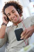 Cheerful attractive man listening to music