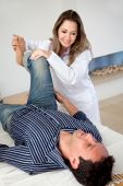 Physiotherapist With A Man