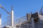 stock photo of scaffolding  - Concrete building under construction - JPG