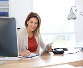 image of 35 to 40 year olds  - Businesswoman in office working with tablet - JPG