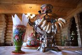 Russian tea drinking with samovar and bread rolls