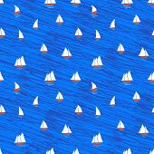 Nautical pattern with small boats on blue waves