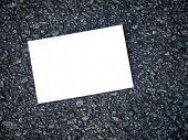 White blank postcard on asphalt texture background