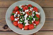 Fried Mini Tomatoes And Seasonings, Seasoned With Parsley And Feta Cheese