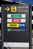 VALENCIA, SPAIN - JANUARY 21, 2014: A rental car sign at the Valencia airport. The rental car indust
