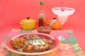 stock photo of enchiladas  - Mexican Enchilada Dinner with frozen Margarita in colorful Mexican Restaurant setting - JPG