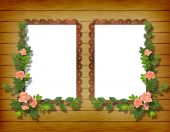 Two Frameworks For Photo On The Wooden Background With Flowers.