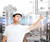 building, developing, construction and architecture concept - concentrated male architect in white t