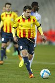 BARCELONA - DEC, 30: Catalan player Jordi Alba of FC Barcelona in action during the friendly match between Catalonia and Cape Verde at Olympic Stadium on December 30, 2013 in Barcelona, Spain