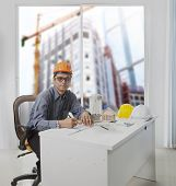 Architect Engineer Working In Office Room Against Building Construction Through Mirror Window  Use F