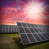 stock photo of sustainable development  - Solar panels against dramatic sky - JPG