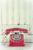 Red Telephone On Wooden Chair