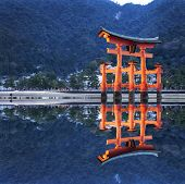 foto of yakima  - Tori reflection in water at hiroshima Japan - JPG