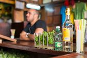 HAVANA,CUBA - JANUARY 20, 2014:Mojitos,a well known cuban cocktail being prepared at La Bodeguita de