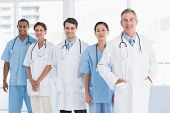 Group portrait of doctors standing in a row at the hospital