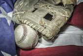 major league baseball with American flag and glove