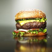 stock photo of beef-burger  - burger with melted cheese and sesame bun - JPG