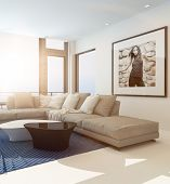 Modern comfortable living room interior with an upholstered beige lounge suite in front of a large window and artwork on the wall