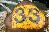 stock photo of bollard  - A mooring bollard marked with the number thirty three.  Quay at Southampton Docks, Hampshire.