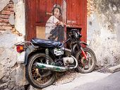 Boy On Bike Street Art Mural In Georgetown, Penang, Malaysia
