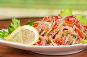 Fresh salad with funchozy, meat and vegetables