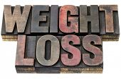 weight loss - isolated words in vintage letterpress wood type with ink patina