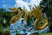 Colorful Dragon Statue With Blue Sky At Public Park