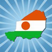 Niger map flag on blue sunburst illustration