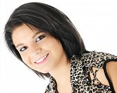 Head and shoulders image of a beautiful, dark-haired teen girl,  On a white background.