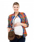Beautiful pregnant white woman wearing shirt with hands on belly isolated