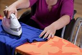 Disabled Woman During Ironing