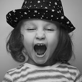 Shouting Angry Kid Girl Face. Closeup. Black And White Portrait