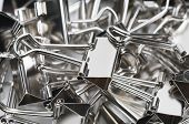 Heap of binder clips, close-up