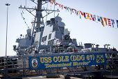 STATEN ISLAND, NY - MAY 25, 2014: The ships banner hangs from the metal gangplank of the guided-missile destroyer USS Cole (DDG 067) moored at Sullivans Piers during Fleet Week NY.