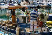 Piran, Slovenia - 10 August 2006: Fisherman on a fishing boat.