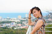 Woman Poses On A High Point Overlooking The City.