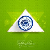 Asoka Wheel with white and saffron color triangle on shiny green background for Indian Independence