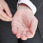 Businessman Holds Empty Handful Close Up