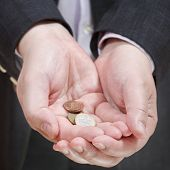 Little Of Coins In Businessman's Handful