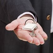 Blank Door Keychain On Businessman's Palm