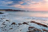 picture of bute  - Colorful sunrise on the beach of Traigh Mor Isle of Iona Inner Hebrides of Scotland - JPG