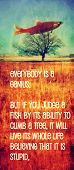 a quote with a fish in a tree toned with a warm instagram like filter (image is blurred - focus on t